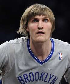 Nets forward Andrei Kirilenko looks on against the