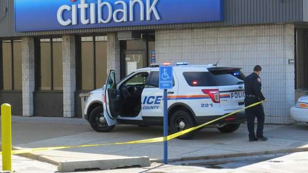 Police investigate a bank robbery in Hicksville Saturday,