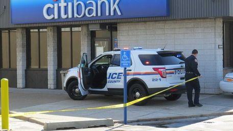 Police investigate a bank robbery in Hicksville Saturday,
