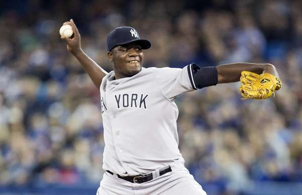 New York Yankees starting pitcher Michael Pineda throws