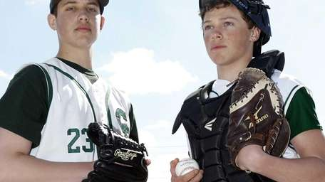 Carl Place pitcher Mike Delio, left, and catcher