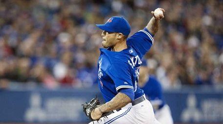 Toronto Blue Jays relief pitcher Sergio Santos delivers