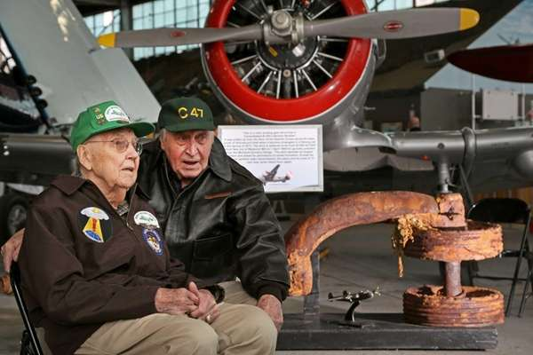 B-24 crewmen Jack McMullen, 91, left, of Seaford,