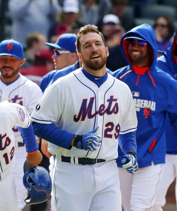 Ike Davis of the Mets celebrates his ninth-inning,