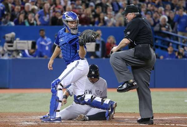 Josh Thole of the Toronto Blue Jays shows