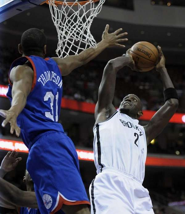Nets' Kevin Garnett shoots over Philadelphia 76ers' Hollis