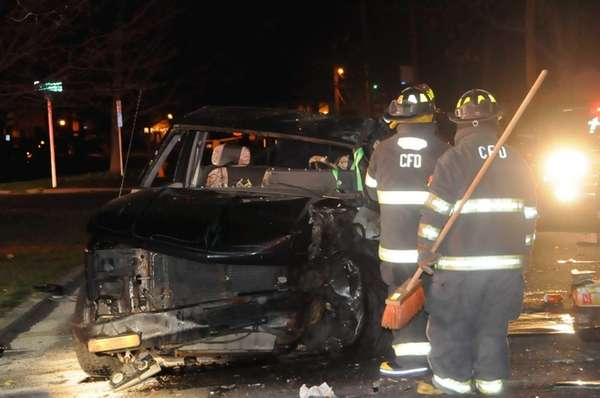 Firefighters at the scene of a one-car crash
