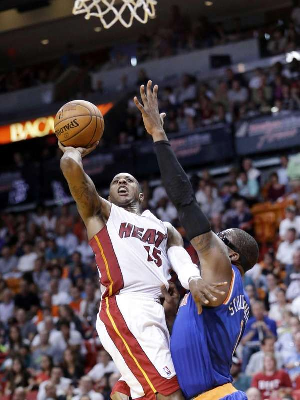 The Heat's Mario Chalmers goes up for a