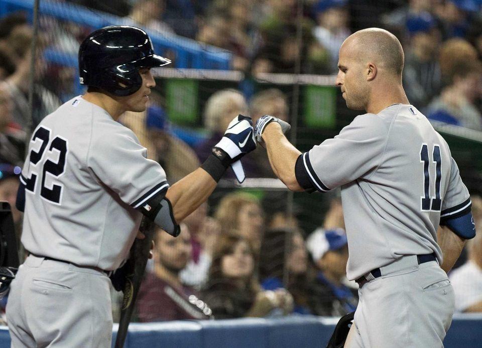 Brett Gardner, right, celebrates his two-run home run