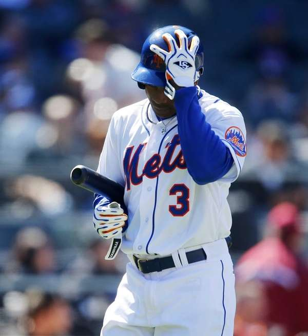 Curtis Granderson walks back to the dugout after