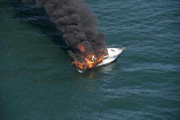 A 36-foot motor boat is engulfed in flames