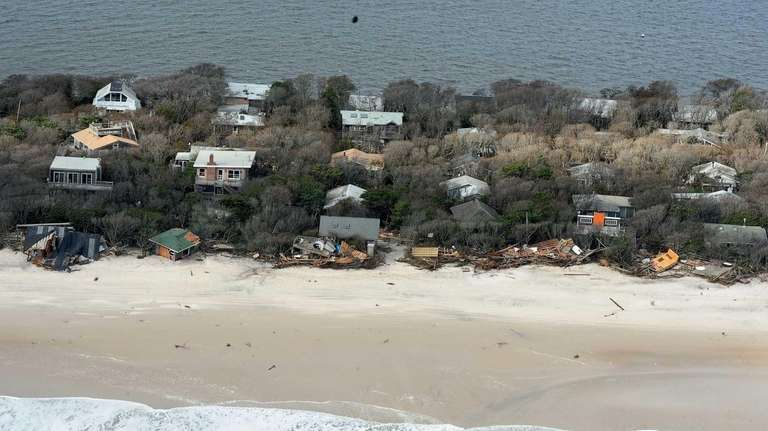 Aerial views showing debris from destroyed oceanfront homes
