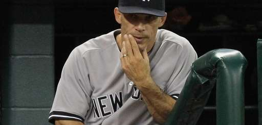 Joe Girardi looks on from the bench against