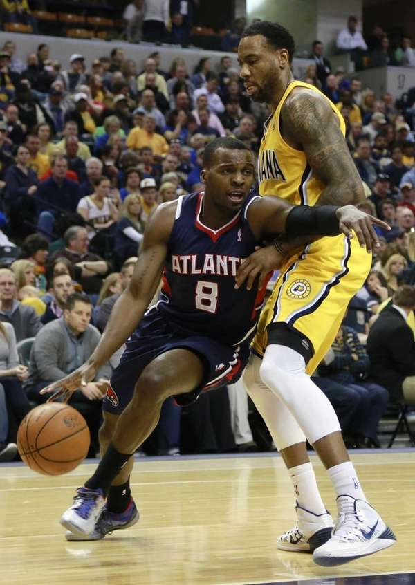 Hawks guard Shelvin Mack pushes his way past