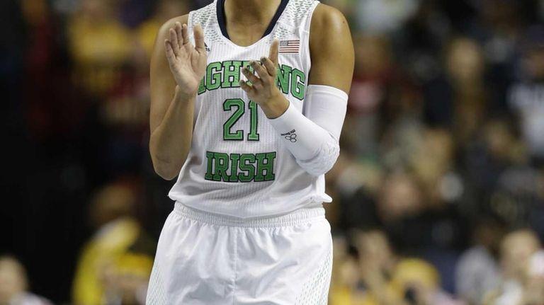 Notre Dame guard Kayla McBride celebrates a score