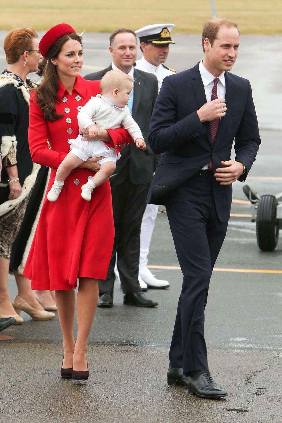 Catherine, duchess of Cambridge, carrying baby Prince George,