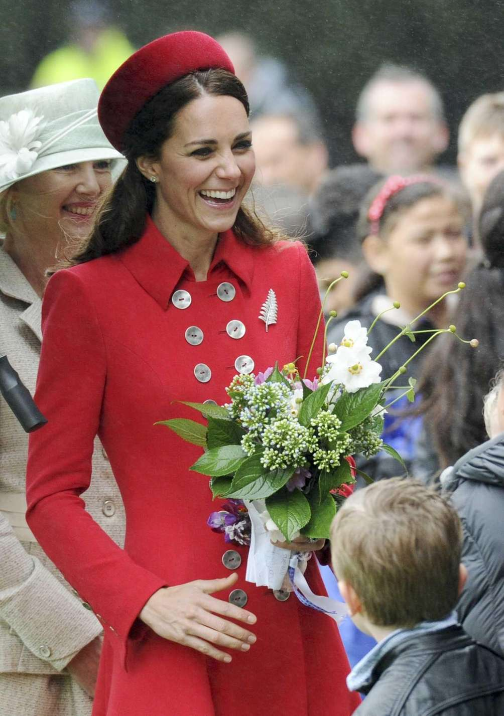 Catherine, the duchess of Cambridge, chats with school