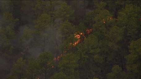A brush fire burns Sunday, April 6, 2014,