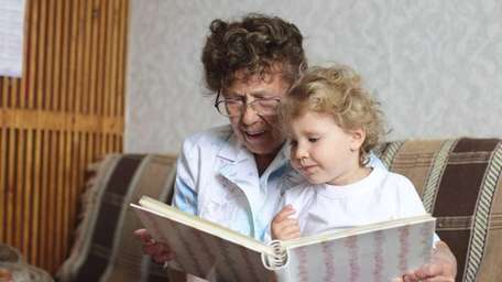 Reading a book to your young grandchildren can