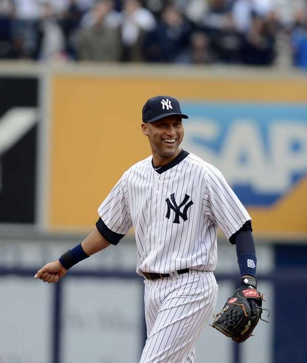 Derek Jeter smiles on the field during the