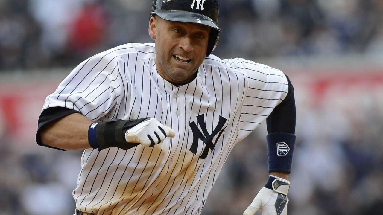 Derek Jeter rounds third as he comes home