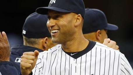 Derek Jeter of the Yankees reacts after the