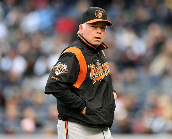 Orioles manager Buck Showalter walks back to the
