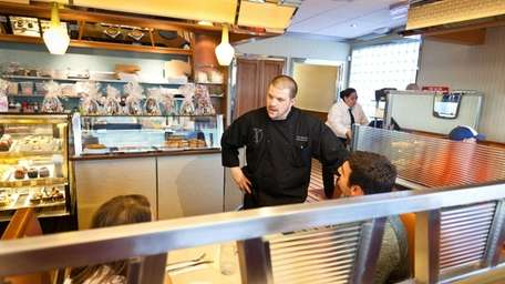 Chef Steven Del Lima chats with customers at