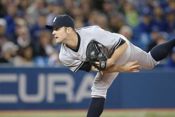 David Robertson of the Yankees delivers a pitch