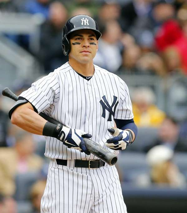 Jacoby Ellsbury of the Yankees looks on against