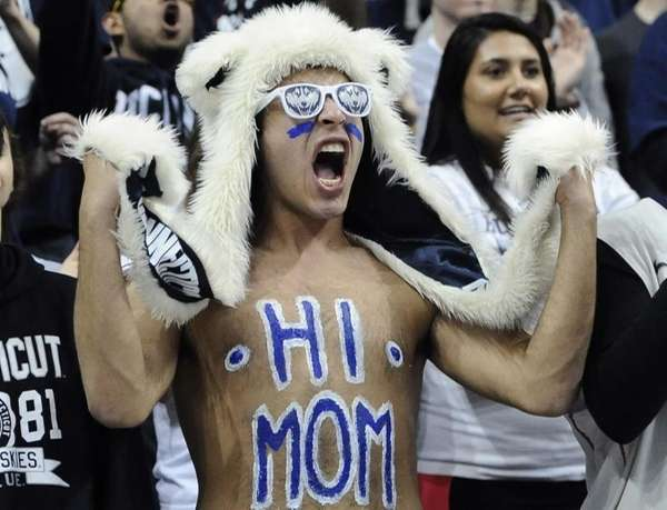 A Connecticut student cheers inside Gampel Pavilion in