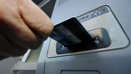 A person demonstrates using a credit card in