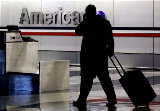 A passenger walks through an American Airlines baggage