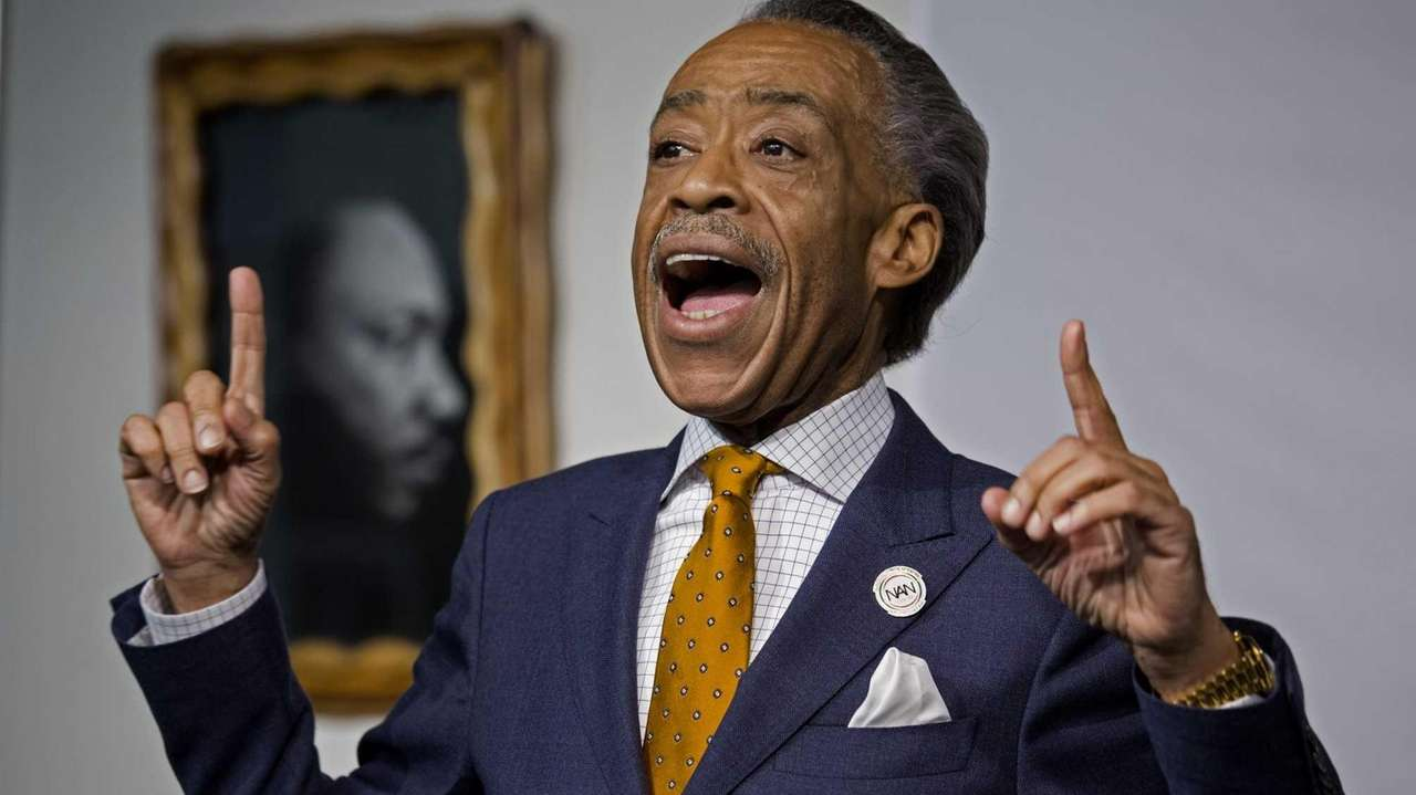 The Rev. Al Sharpton addresses the media at