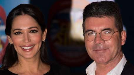 Lauren Silverman and Simon Cowell attend the press