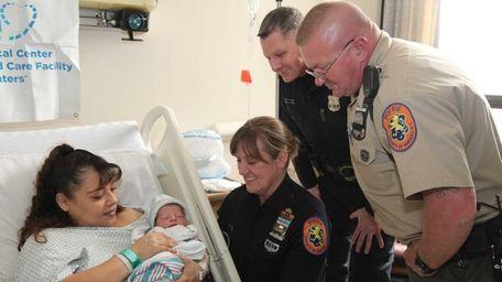 Zulma Gutierrez, of Westbury, holds her newborn baby,