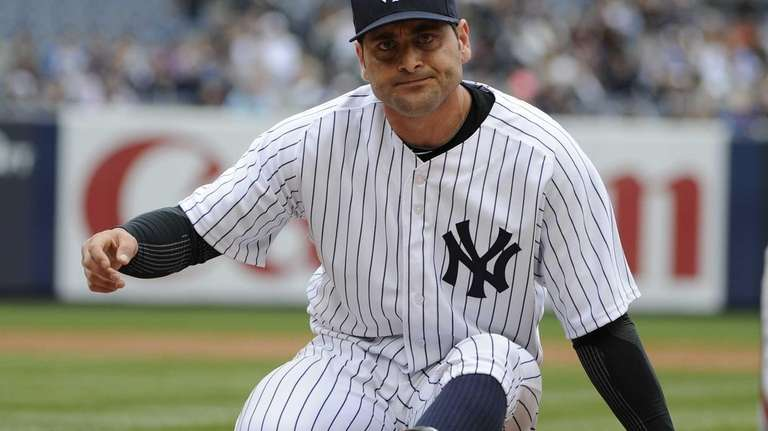 Yankees first baseman Francisco Cervelli reacts after he
