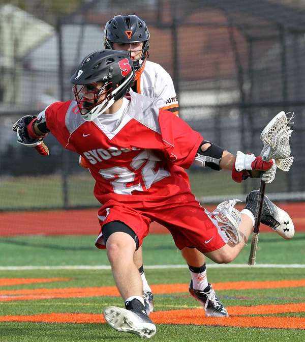 Syosset's Anthony Carchietta works inside against Hicksville on