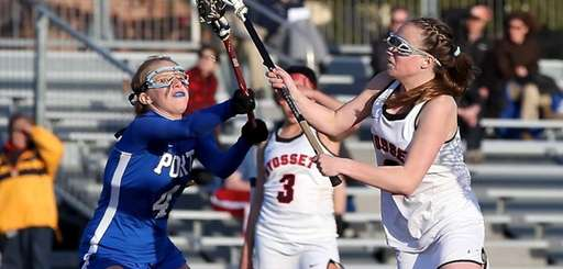 Syosset's Morgan Lannig shoots and scores past Port