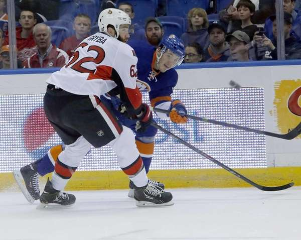 Islanders' Frans Nielsen takes a shot on goal