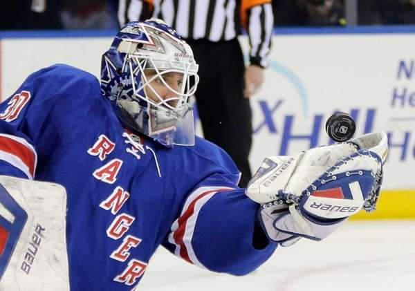 Rangers goalie Henrik Lundqvist catches a Carolina Hurricanes