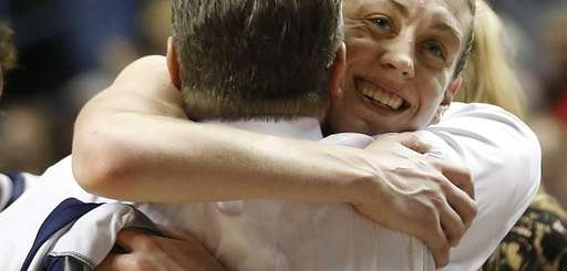 Connecticut forward Breanna Stewart embraces Connecticut head coach
