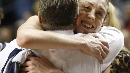 Connecticut forward Breanna Stewart embraces Connecticut head coach