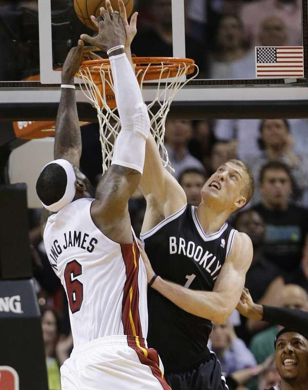 Nets forward Mason Plumlee blocks a shot by