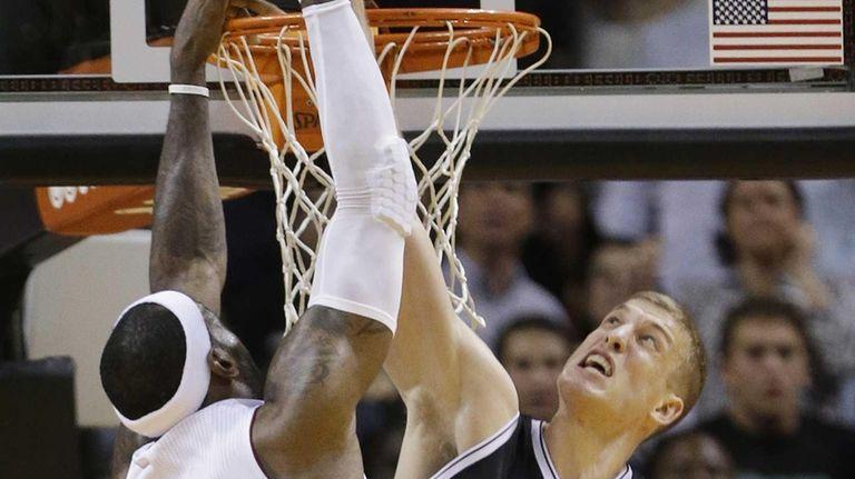 Nets forward Mason Plumlee blocks a shot by