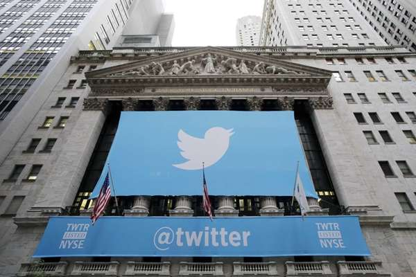 A banner with the Twitter logo hangs on