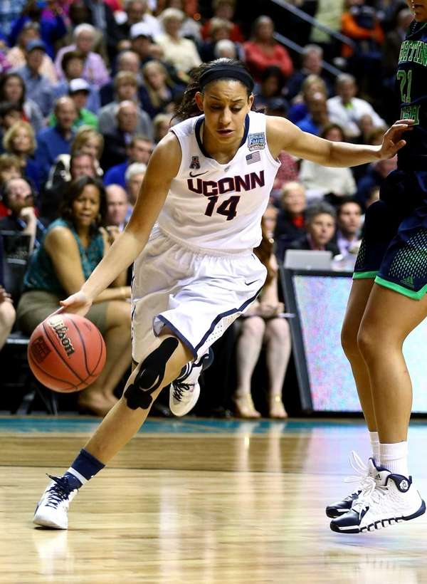 Bria Hartley of the Connecticut Huskies drives to