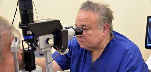 Dr. Salomon Melgen examines a patient's eyes at