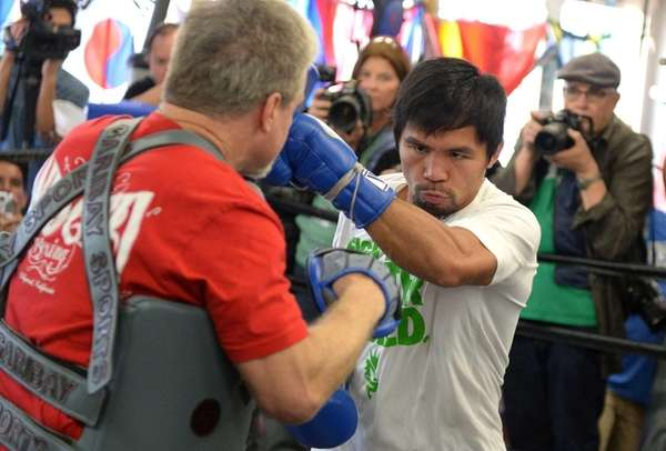 Manny Pacquiao and his coach Freddie Roach take