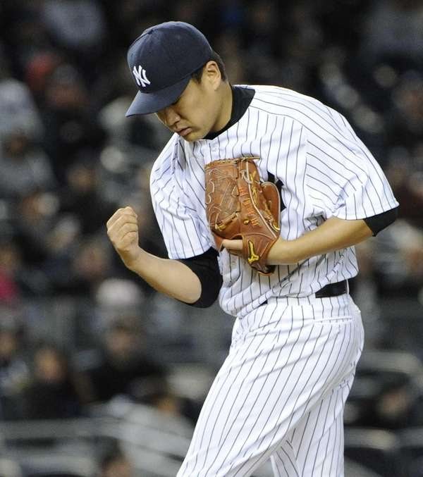 Yankees starting pitcher Masahiro Tanaka gestures on the